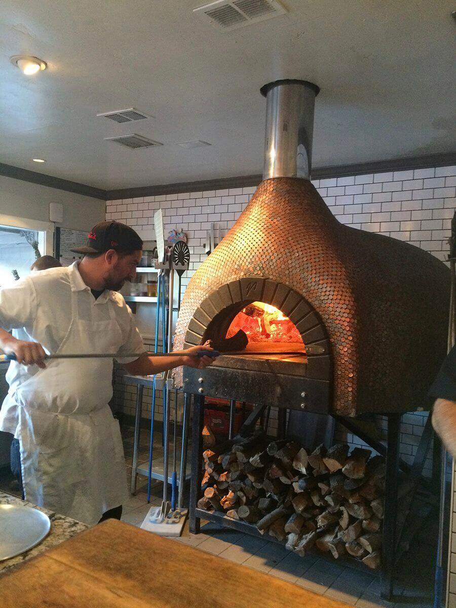 Chef using Mugnaini oven