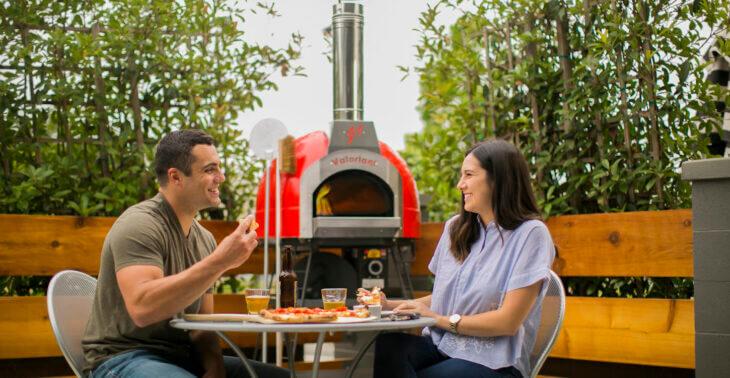 Couple with Mugnaini Piccolo 60 Oven