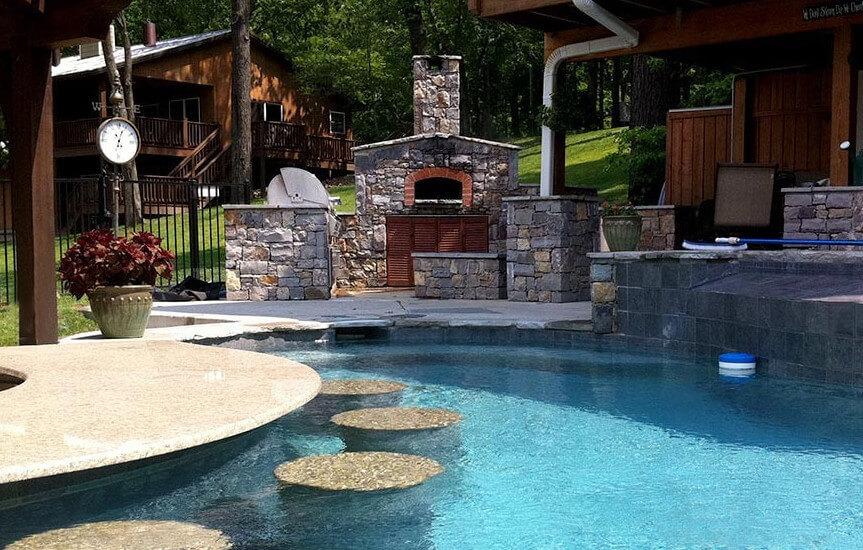 Mugnaini oven next to a pool