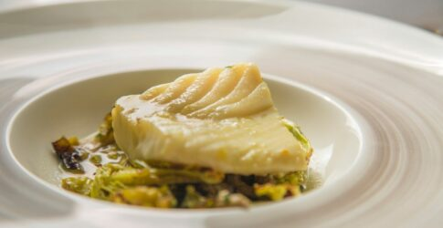 Striped Bass Braised in Mussel Liquor with Brussel Sprouts, Cabbage and Fresno Chili