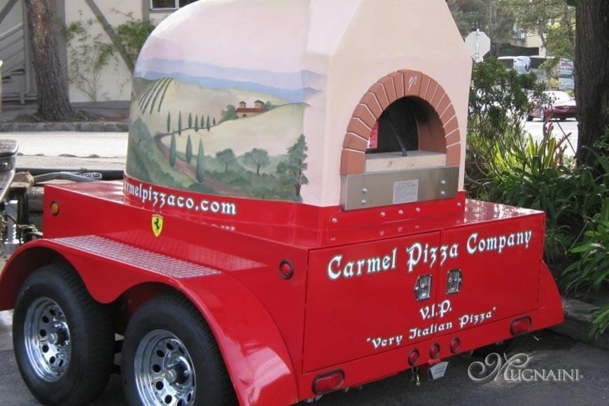 Mugnaini oven on Carmel Pizza trailer