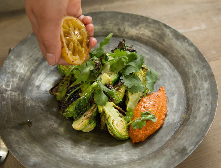 Charred Brussels Sprouts with Walnut Romesco and Roasted Lemon